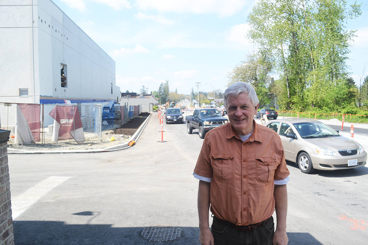 KURT LANGMANN PHOTO With the new Aldergrove Credit Union Community Centre and highway improvements looming behind him, Aldergrove Fair Days director Mike Robinson says the town will mark Canada Day with a giant Parade this July 1.