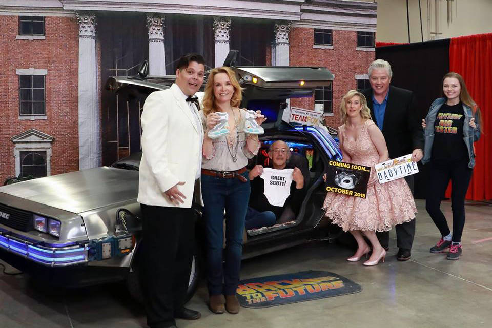 Todd, left, and Nicole Cameron, third from right, pose with Back to the Future cast members Leah Thompson, Christopher Lloyd, Tom Wilson and Todd's daughter Raven McDonald when they officially announced Nicole's pregnancy at the Calgary Comics and Entertainment Expo in April. (Photo Submitted)