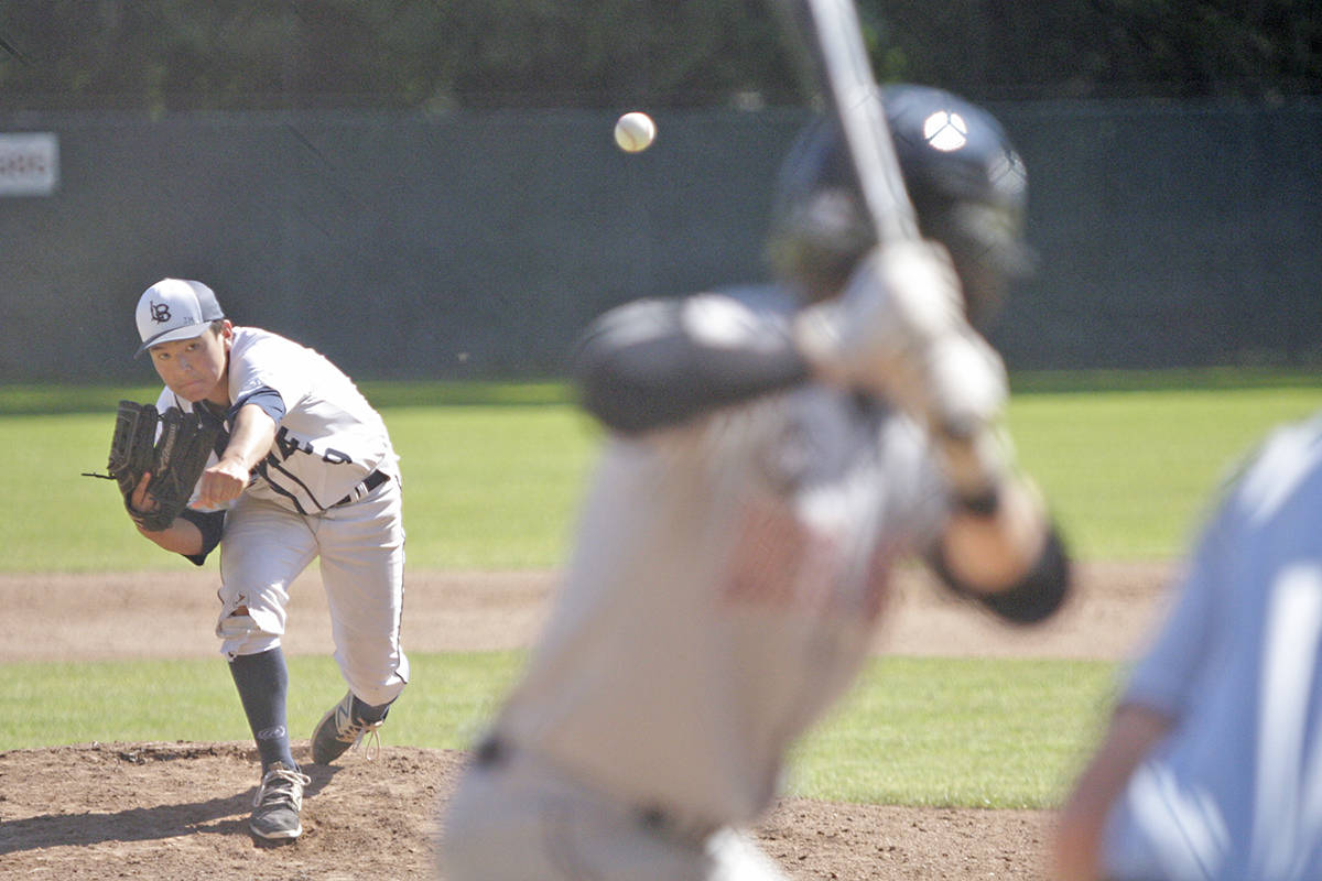 Langley Blaze's Sean Sasaki delivers a pitch during game two of Saturday's doubleheader against the North Shore Twins at McLeod Athletic Park. The teams each won once.                                Dan Ferguson Langley Times