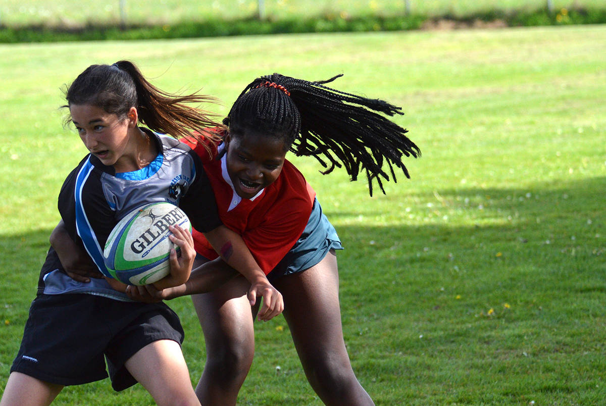 Yorkson Creek Wolves vs Poppy Redhawks, Grade 8 girls rugby at DW Poppy Secondary, May 3 Gary Ahuja Langley Times