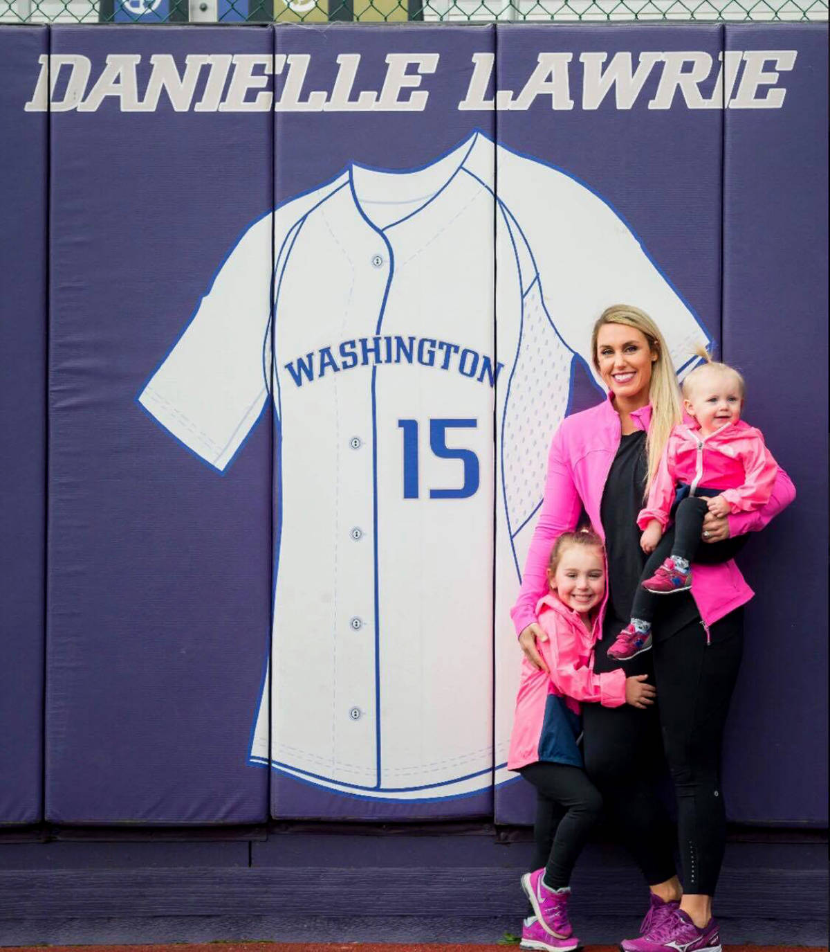 Danielle Lawrie-Locke poses with her daughters, Madison and Audrey at Husky Stadium where her No. 15 jersey was retired by the University of Washington in 2014. Lawrie-Locke is attempting a comeback with the Canadian national team program.                                Photo courtesy of Morgan Henry Photography