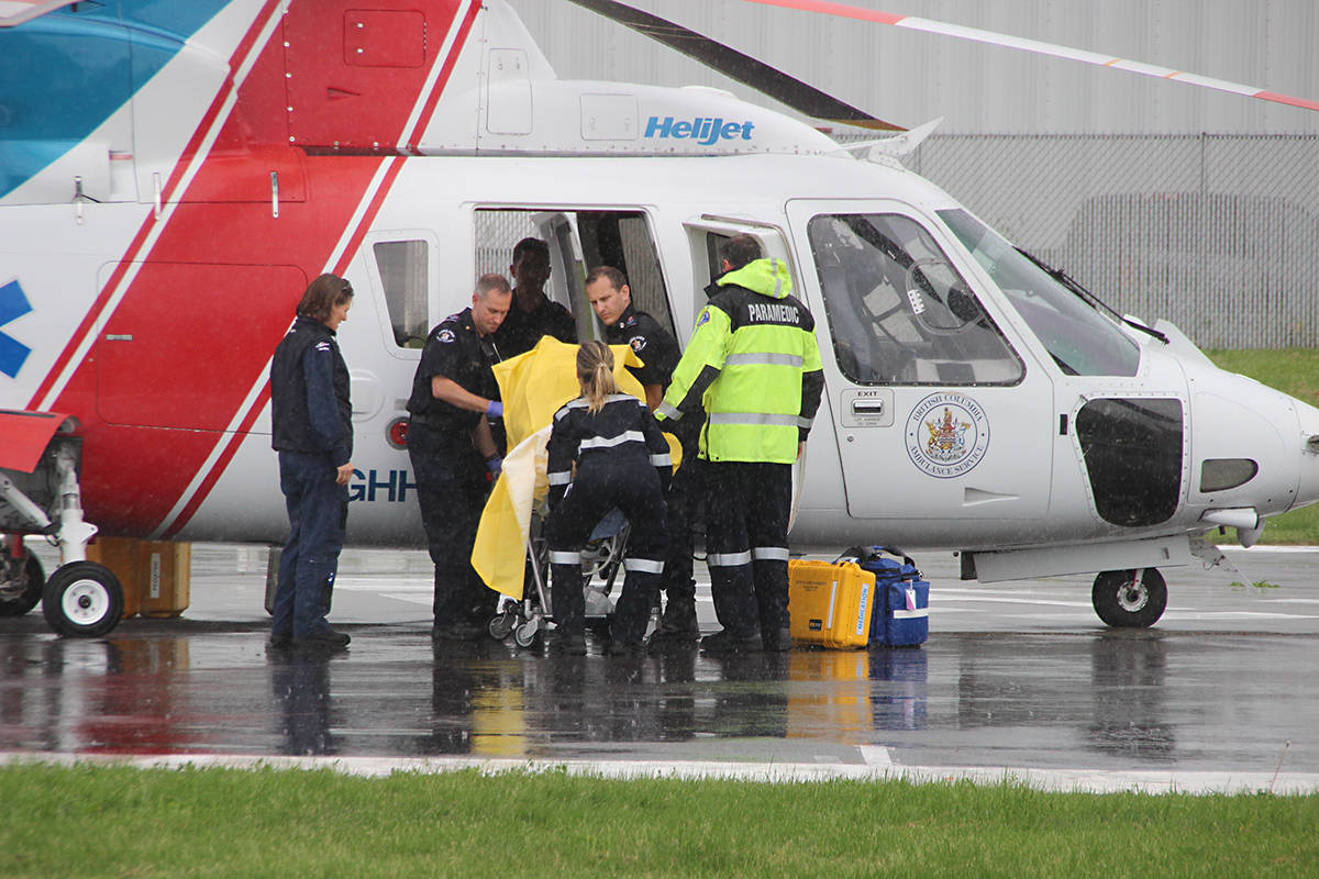 A child who fell out of a window in Langley City on Wednesday afternoon is loaded onto an air ambulance. Shane MacKichan photo
