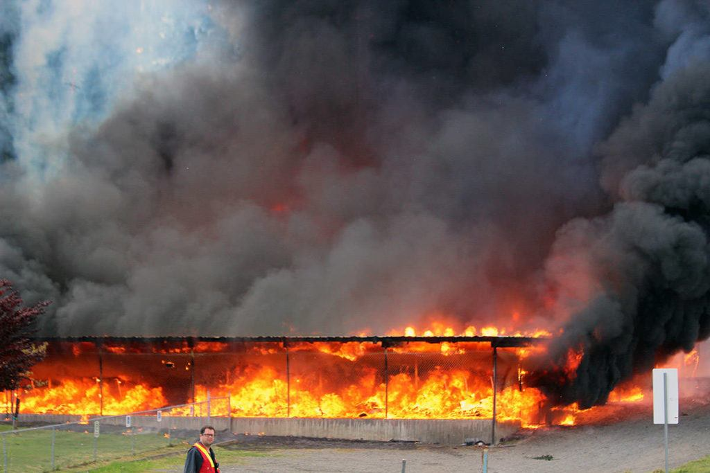 Massive amounts of flame and smoke burst out from kart storage facility. (Photo by Don Bodger)