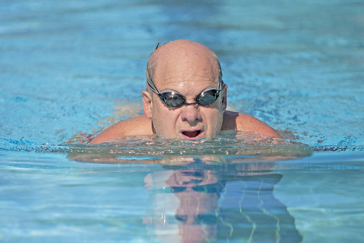 Tom Reinhart enjoys some early morning laps at the Al Anderson Memorial Pool in Langley City. The outdoor pool reopened Friday. Dan Ferguson Langley Times