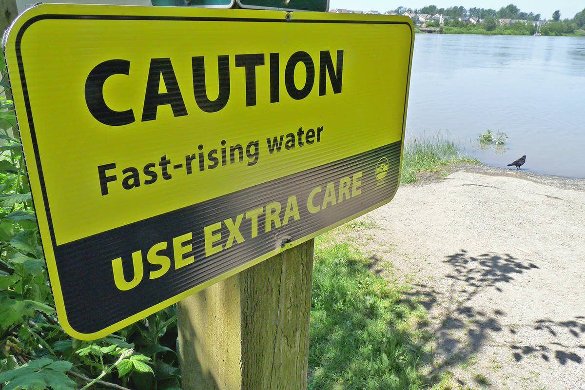 Warning signs were up at the edge of the river. Dan Ferguson Langley Times