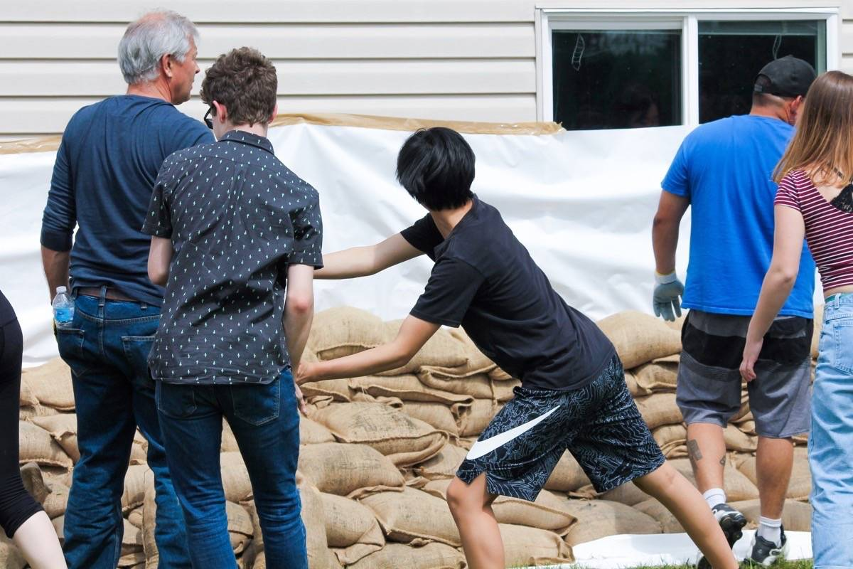 More than 200 students helped the Katzie and Kwantlen First Nation prepare for potential flooding. Submitted photo by Anthony Biondi