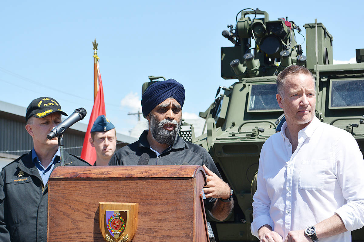 Defence Minister Harjit Sajjan, speaking to the media in Kelowna Monday flanked by Admiral Art McDonald of the Canadian Navy, commander of Joint Task Force Pacific (left) and Kelowna-Lake Country MP Stephen Fuhr. —Image: Alistair Waters/Capital News