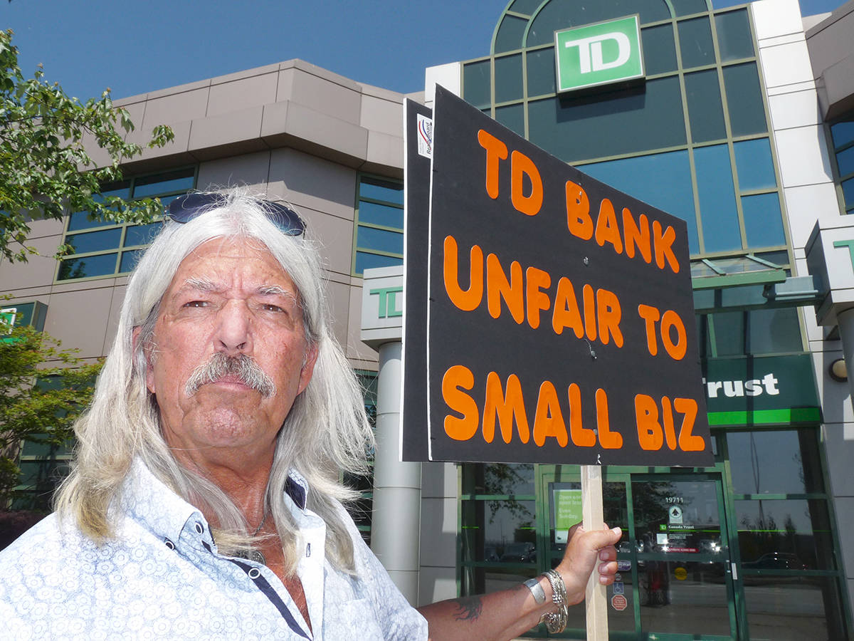 HEMPYZ owner Randy Caine was picketing his TD bank branch to protest their refusal to switch a personal line of credit into the name of his business. The Langley resident said the bank balked because of the nature of his business, a chain of hemp-related shops. Dan Ferguson Langley Times