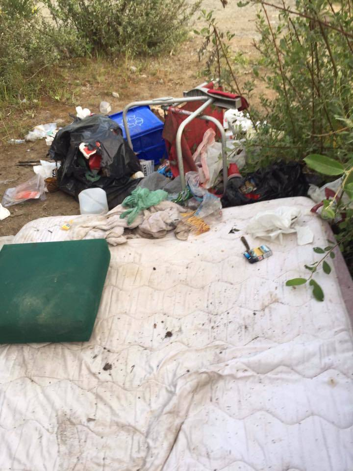 Vehicle and camper parts, garbage, a mattress, lawn chairs, beer cans and boxes, and even fecal matter and female hygiene products were left behind by campers along Gordon River Road in Port Renfrew on May long weekend. (Photo contributed by Cynthia Carlsen)