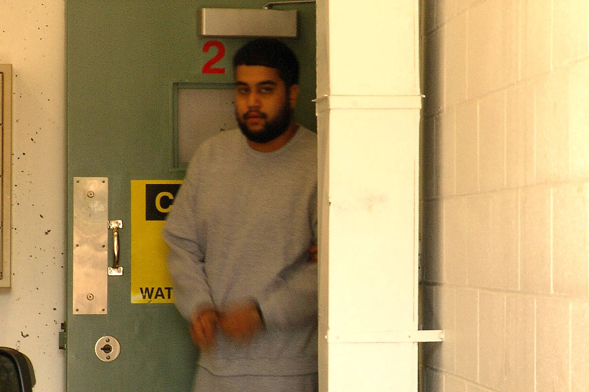 Jaspaul Uppal is seen leaving the Abbotsford Police Department on Wednesday en route to his transfer to the Vancouver Airport and then to Peel Regional Police. (Kevin MacDonald photo)