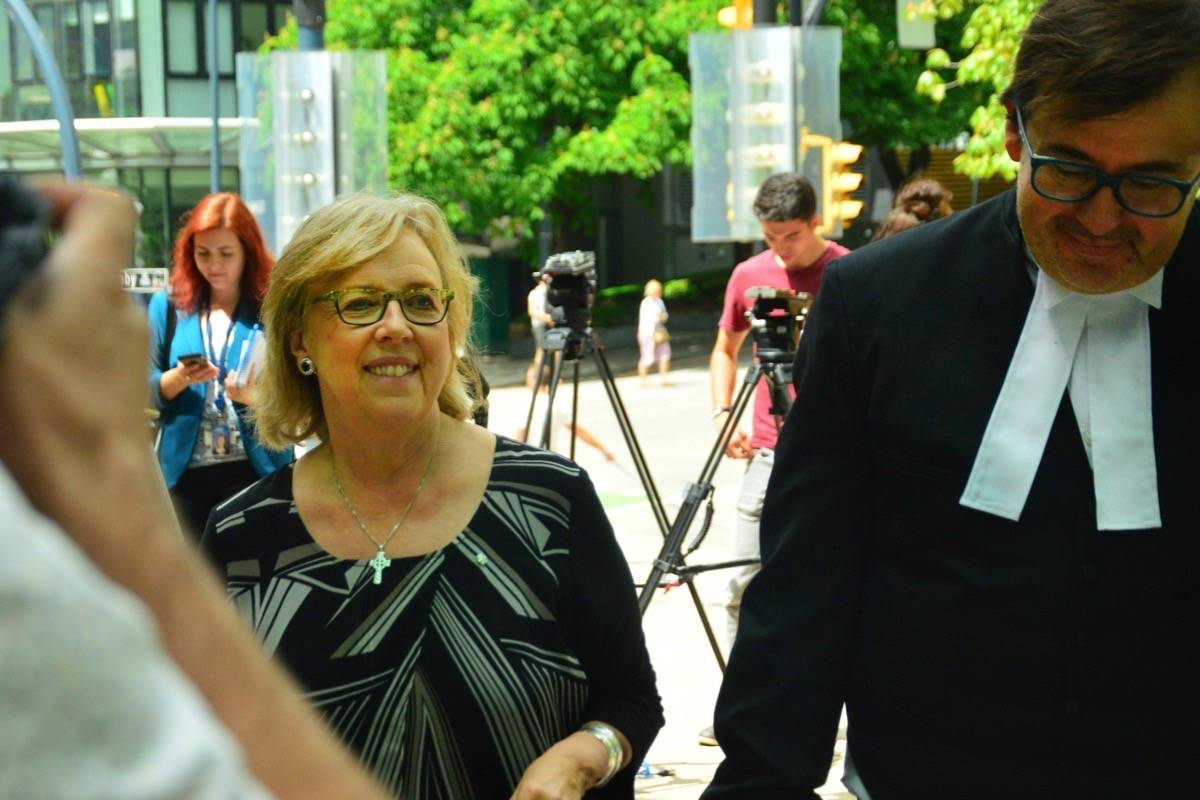 Green Party of Canada Leader Elizabeth May is all smiles after after being found guilty of criminal contempt at B.C. Supreme Court in Vancouver Monday. (Katya Slepian/Black Press)