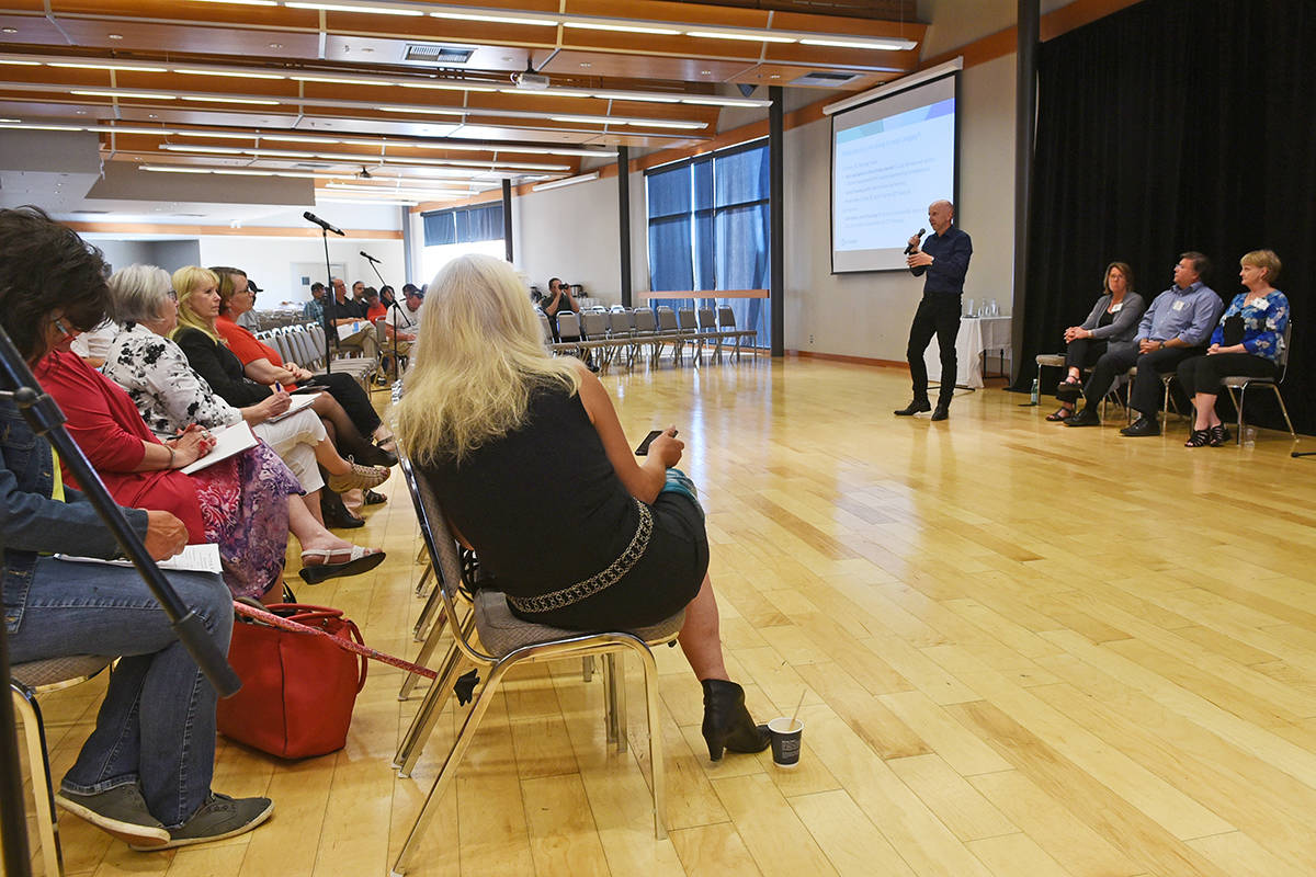 Dominic Flanagan, Executive Director, Strategic Initiatives on Homelessness at BC Housing, speaks to dozens of Langley residents at a public information meeting on the Qulity Inn proposal on May 28. Miranda Gathercole Langley Times