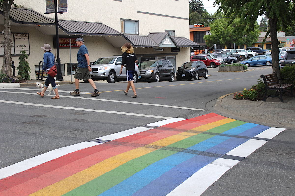 A new rainbow sidewalk in Courtenay was vandalized shortly after it was painted Friday. Scott Stanfield photo