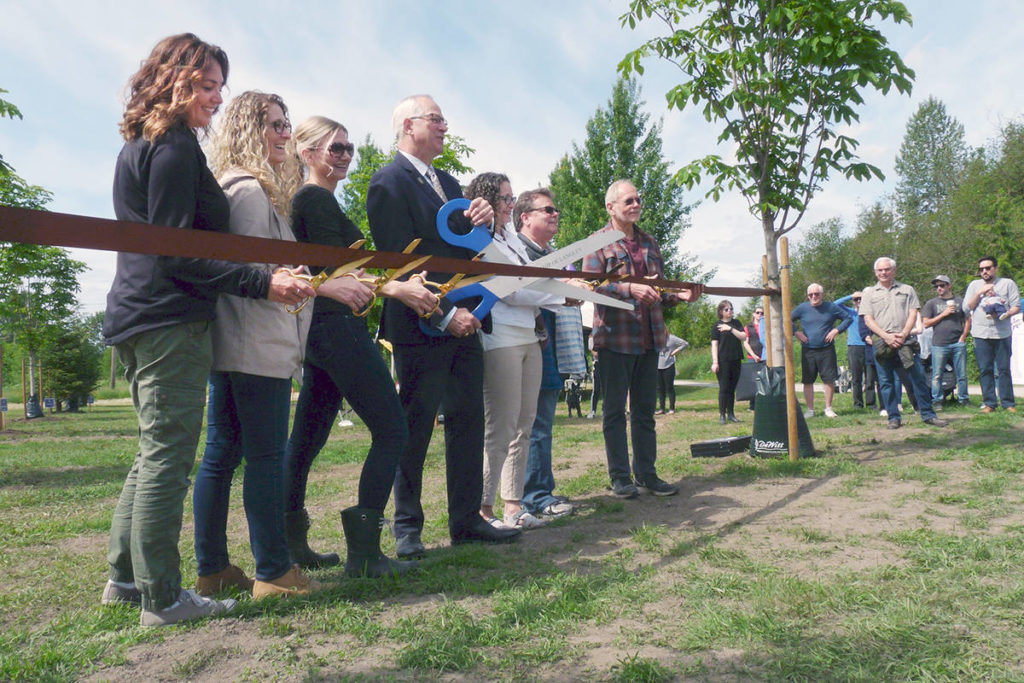 A ribbon-cutting ceremony officially opened the Memory Grove in Fort Langley; below: Janel Doyle named a tree for her son.                                Dan Ferguson Langley Times