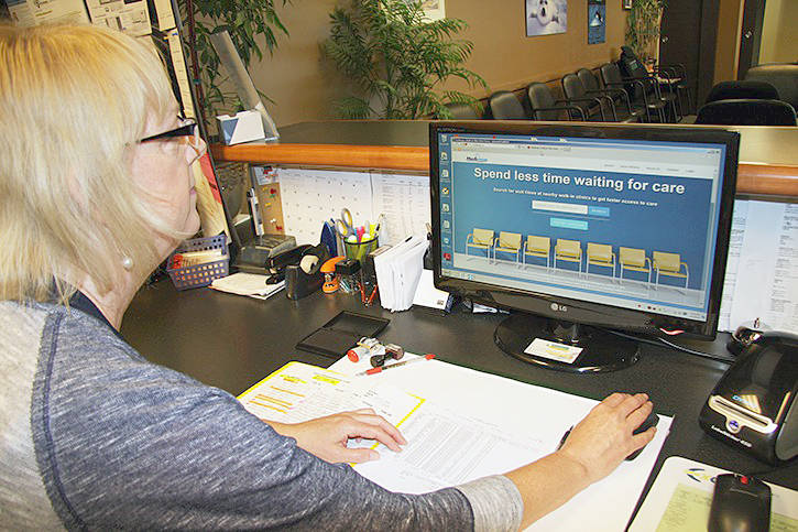 Lorraine Rogers updates wait times at the North Okanagan Medical Clinic on the Medimap website, which alerts patients to how long they should expect to wait at various clinics. (Morning Star file photo)