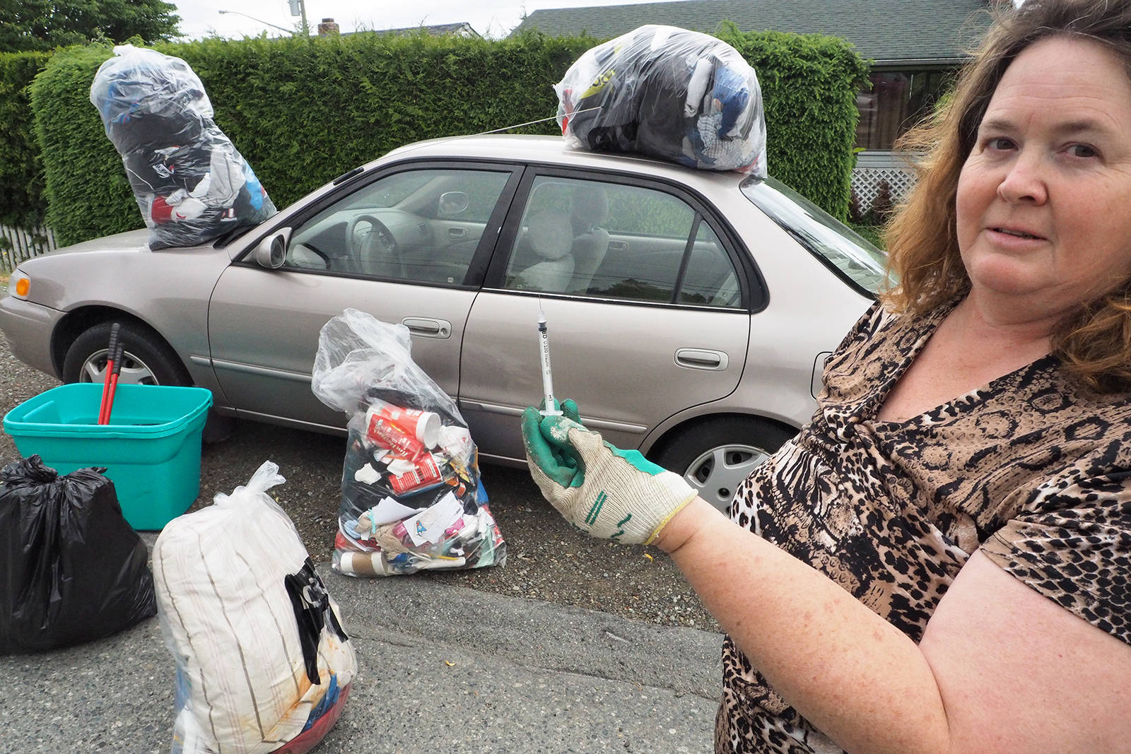 Along with several bags of items left behind by the people who stole her car, Tiffany Braun, of Nanaimo, also found a used syringe next to the seat that was left behind by the ICBC subcontractor hired to 'bio-clean' the vehicle. (CHRIS BUSH/The News Bulletin)