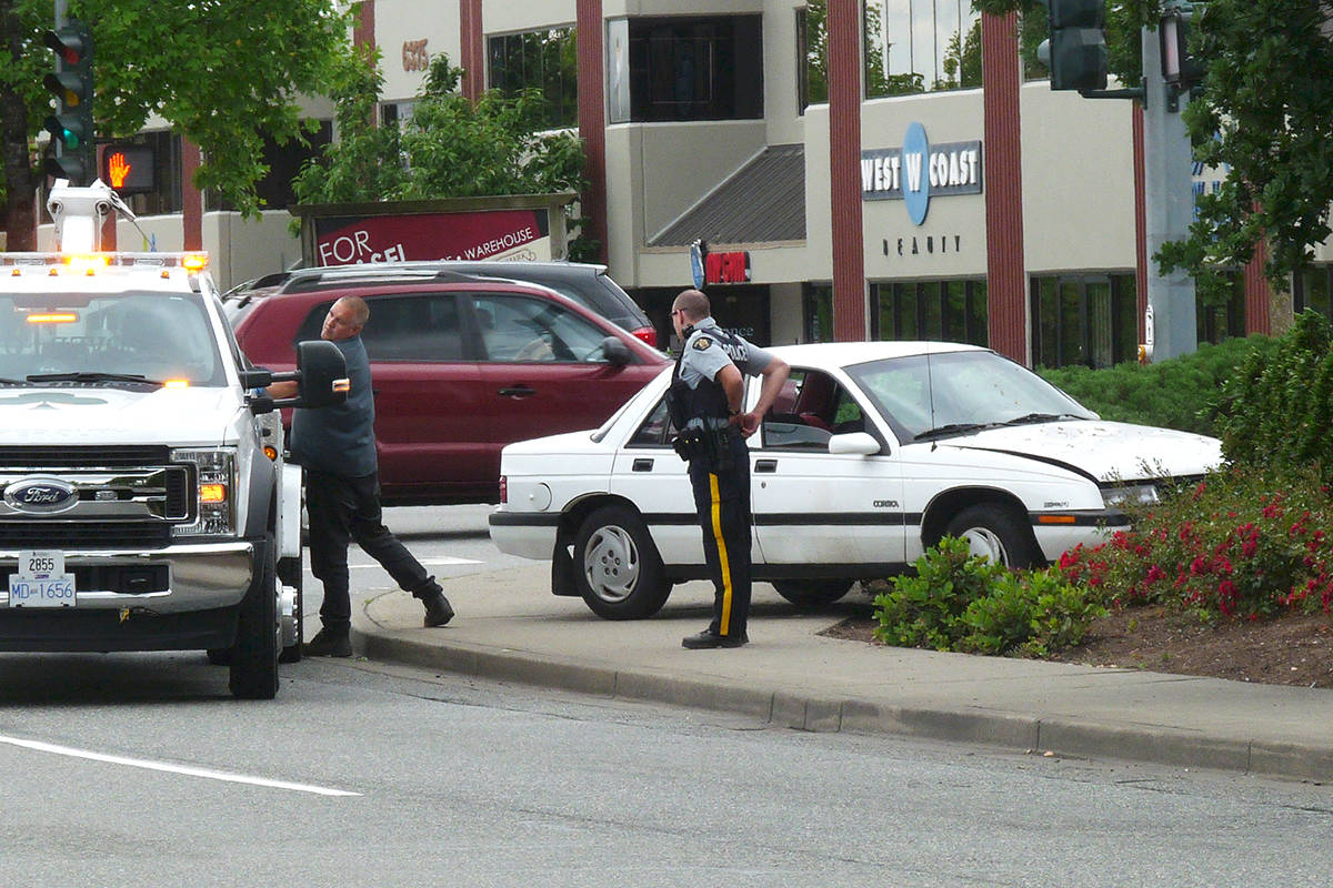 VIDEO: car crash in front of Langley credit union - Langley Times