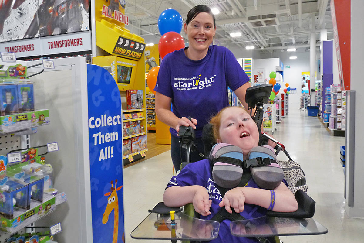 Nine-year-old Charlie-Ann from Vancouver, with mom Cherie, had three minutes to grab as many toys as possible in three minutes at the Langley Toys R' Us store. With help from family and supporters, she filled nine shopping carts. Dan Ferguson Langley Times