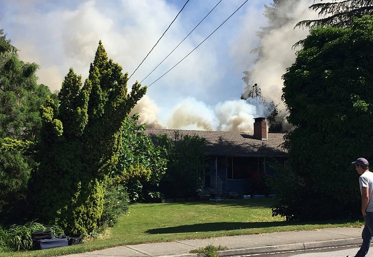 Smoke rises from the house on 123rd Avenue. (Miranda Fatur/THE NEWS)