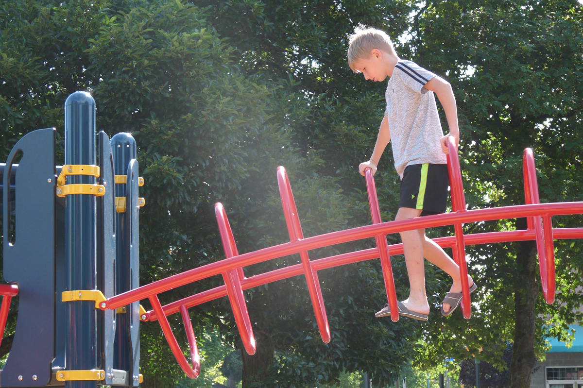 Rhylan Lacey, 9, of Langley, tries out the new playground equipment in Douglas Park. Dan Ferguson Langley Times