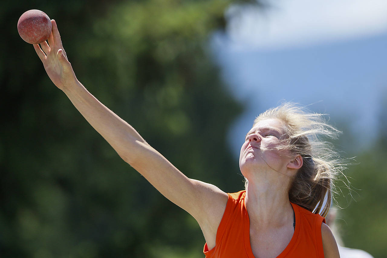 Liepa Bajarunas grimaces during the shot-put at the Cowichan Sportsplex at the BC Summer Games. (Arnold Lim/Black Press)