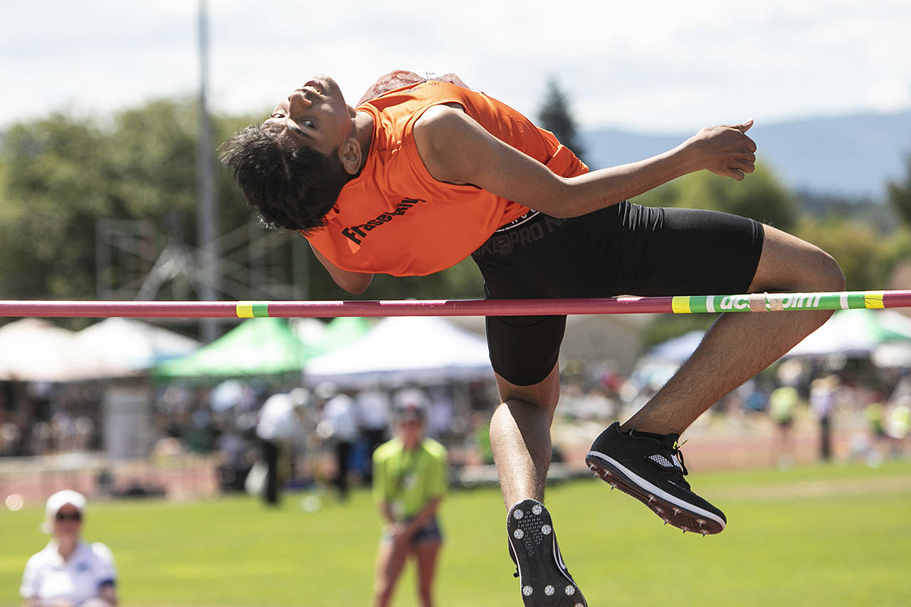 Kiran Wanniarachi from Burnaby competes in the high jump at the Cowichan Sportsplex at the BC Summer Games. (Arnold Lim/Black Press)