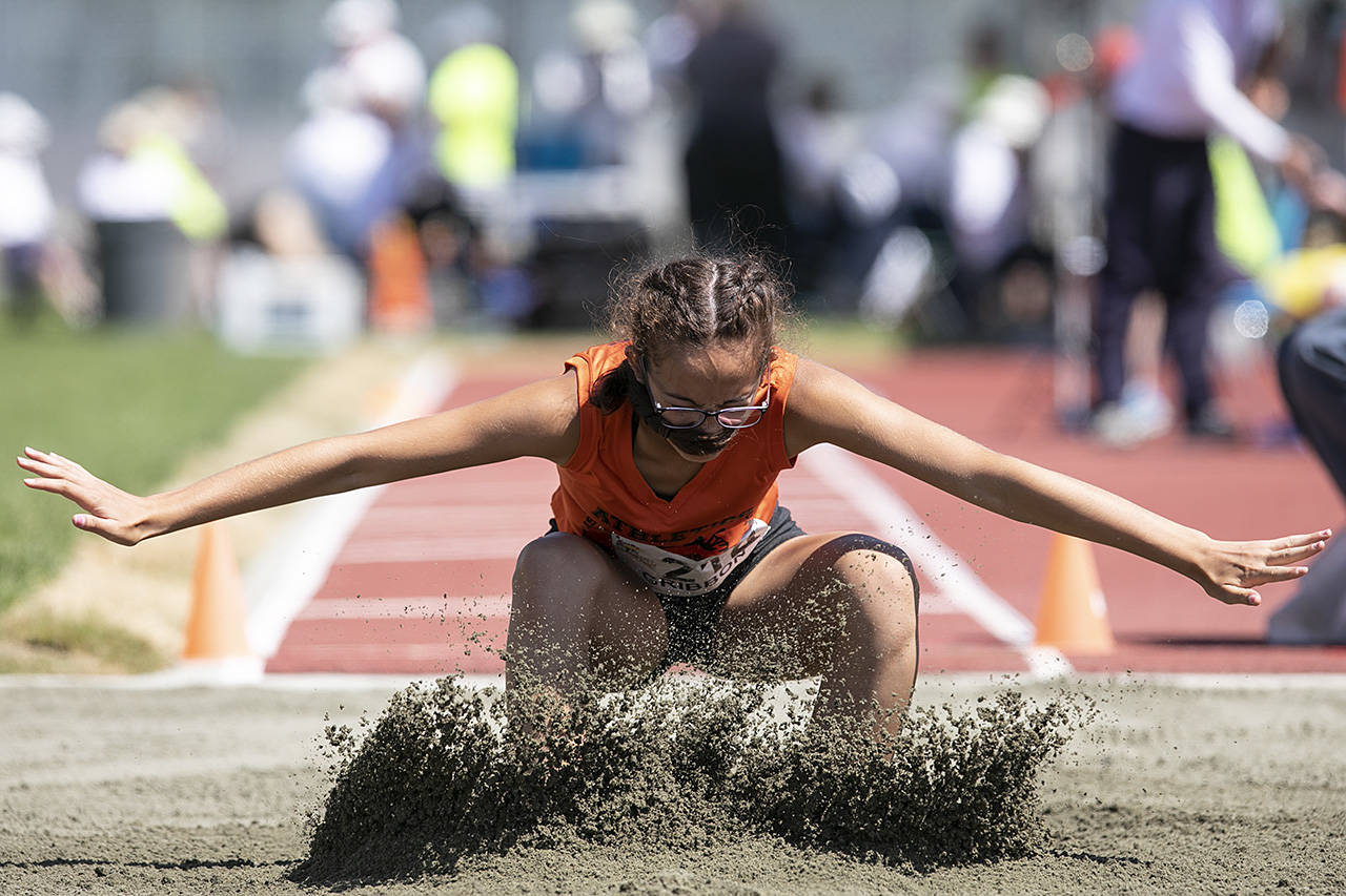 Sophia Gibbon of Zone 4 has her pony tail fly in her face at women's long jump the Cowichan Sportsplex at the BC Summer Games. (Arnold Lim/Black Press)