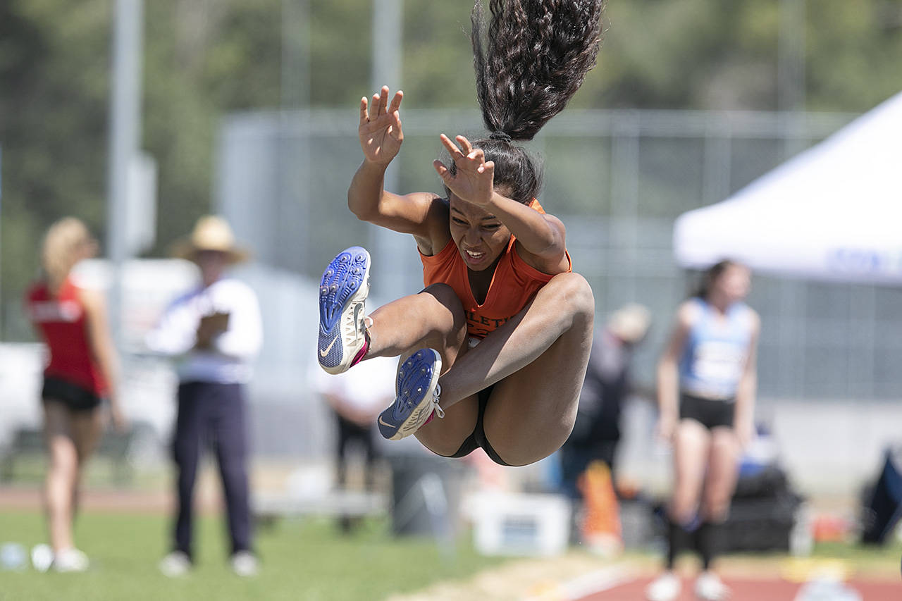 Laysha Tunti leaps through the air at women's long jump the Cowichan Sportsplex at the BC Summer Games. (Arnold Lim/Black Press)