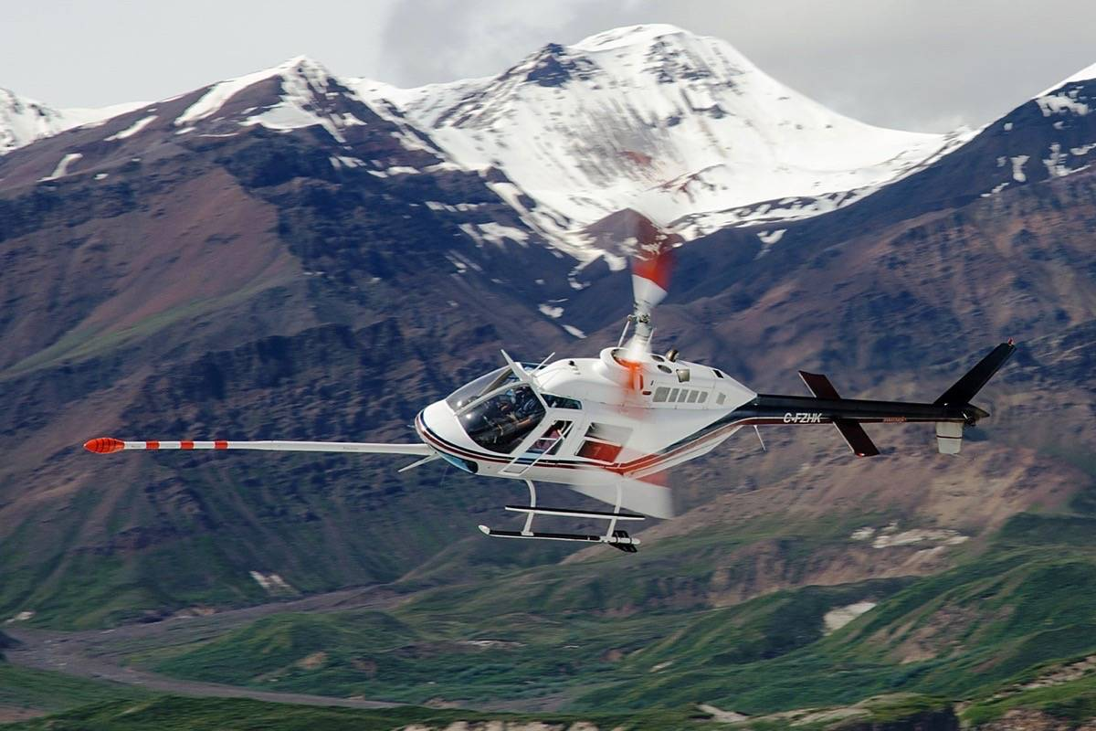 Helicopter maps mineral potential in remote areas using magnetic imaging. (Geoscience BC)