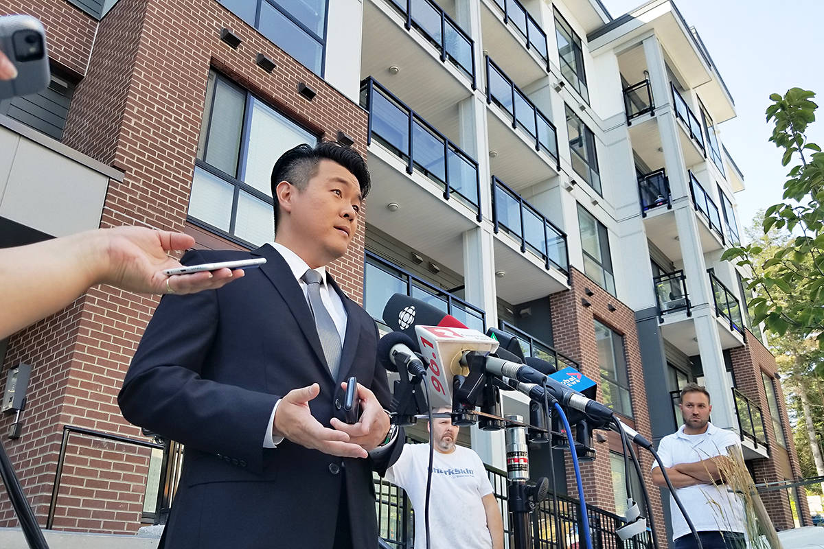 IHIT Cpl. Frank Jang talks to reporters at the Langley residential building where a seven-year-old died. Dan Ferguson Langley Times