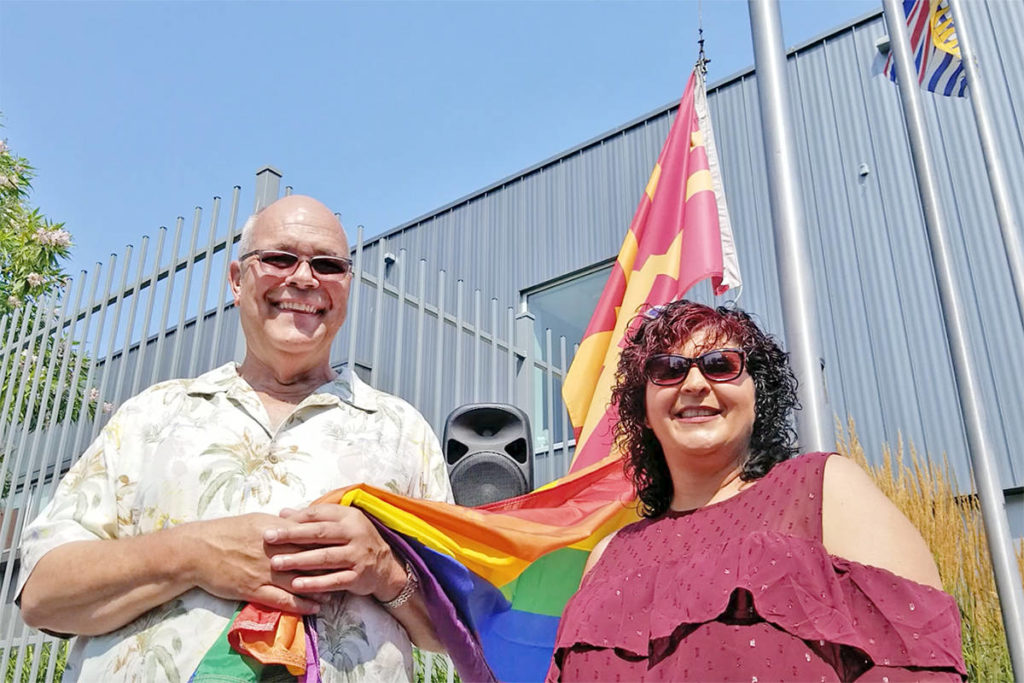 Deputy Langley City mayor Rudy Storteboom and councillor Van van den Broek were among several members of council and the Langley school board who attended the raising of a rainbow flag at City Hall Monday. Attendance was up, possibly in response to a critical letter that said the city should reconsider. Dan Ferguson Langley Times