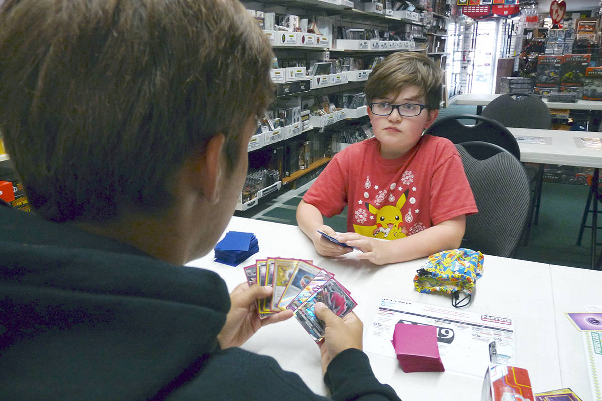 Lucas Oldale, a nine-year-old Grade 4 student from Langley, was preparing for the upcoming world invitational Pokemon card game championships in Nashville by playing 14-year-old Jaxson Piwek from Surrey, who is also going to the Nashville event, at Pastime Sports and Games in Langley City. Dan Ferguson Langley Times
