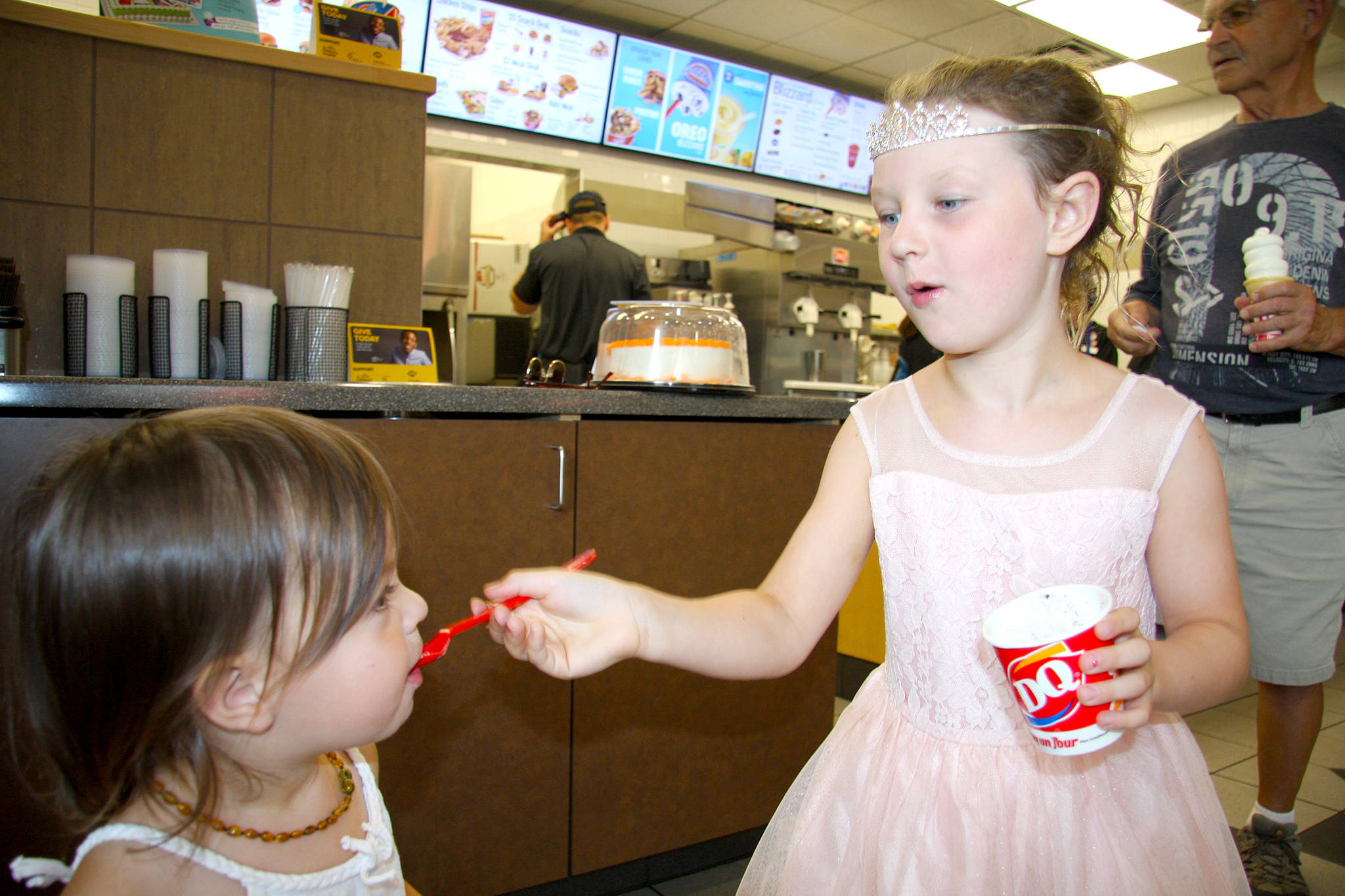 Six-year-old 'Princess' Finnley Bennett shares her Blizzard with two-year-old sister Reylie Thursday during Miracle Treat Day at Dairy Queen. Visit vernonmorningstar.com for more photos and a video on the special day, raising funds for B.C. Children's Hospital. (Jennifer Smith/Morning Star)