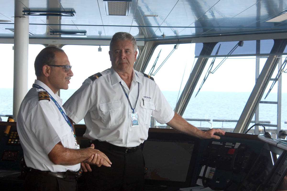 B.C. Ferries Coastal Inspiration captain Behzad Safarizal, left, talks to Steve Hrabove, third officer while heading out of Duke Point terminal. (Nicholas Pescod/NEWS BULLETIN)
