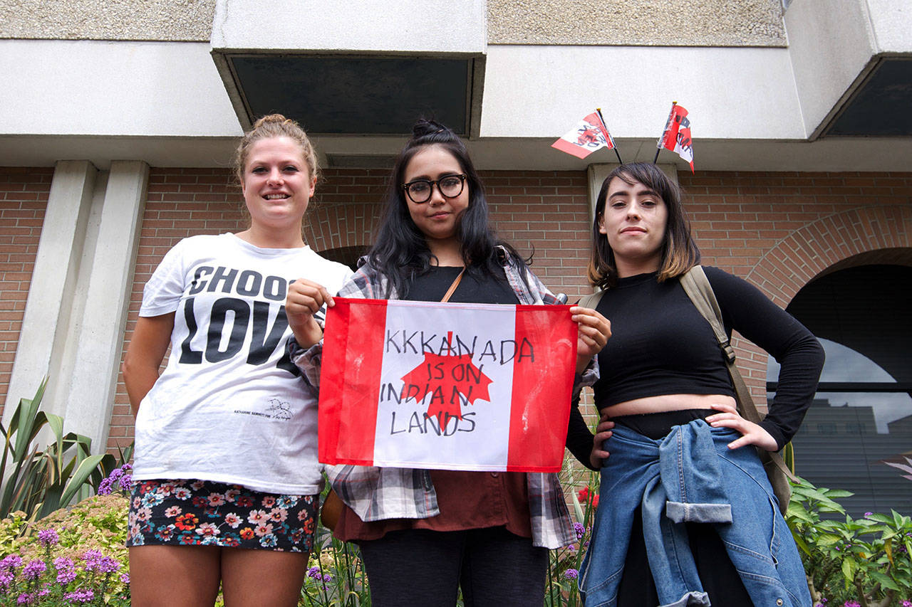 Phoebe Ramsay (left), Samantha, and Lucy Gunn supported the removal of the Sir John A. Macdonald statue from the front steps of Victoria's City Hall. Nicole Crescenzi/VICTORIA NEWS