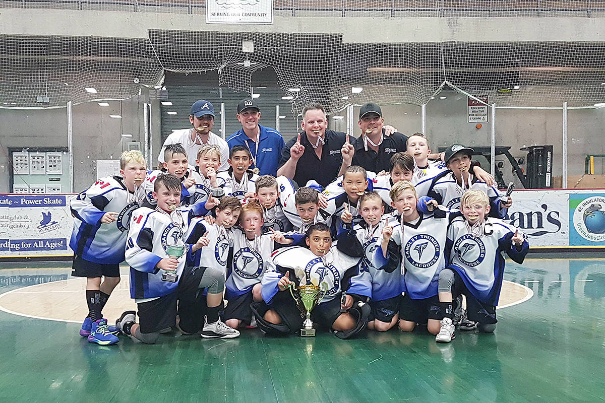 The Langley Thunder Novice A1 Box Lacrosse team celebrate a perfect season. Supplied