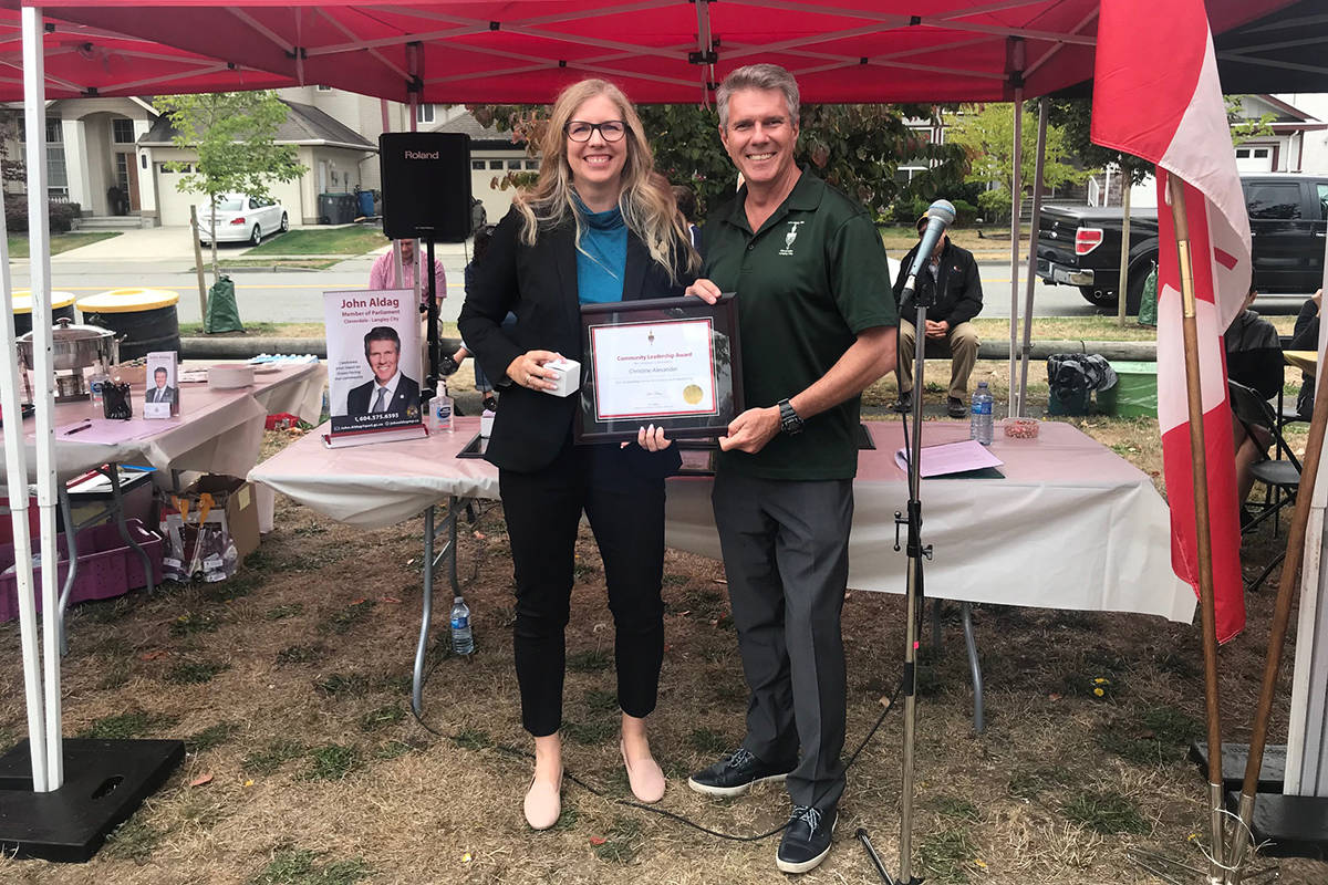 Cloverdale-Langley City MP John Aldag presents Christine Alexander with a Community Leadership Award. (Submitted)