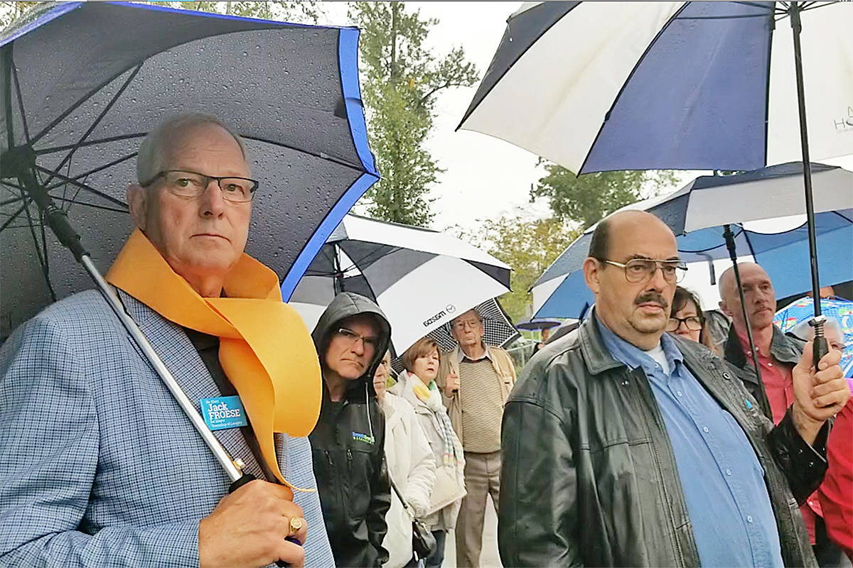 Umbrellas were widely used during a unique outdoor all-candidates meeting held in the pouring rain at a Langley playground. Dan Ferguson Langley Times