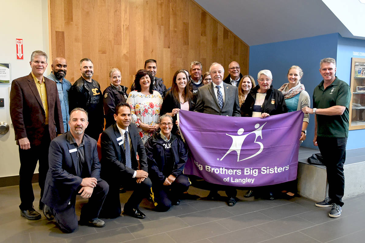 Local dignitaries, RCMP, sponsors and members of BBBS Langley gathered at Langley City hall on Monday morning to do a ceremonial flag raising to mark Big Brothers Big Sisters month. Miranda Gathercole Langley Times