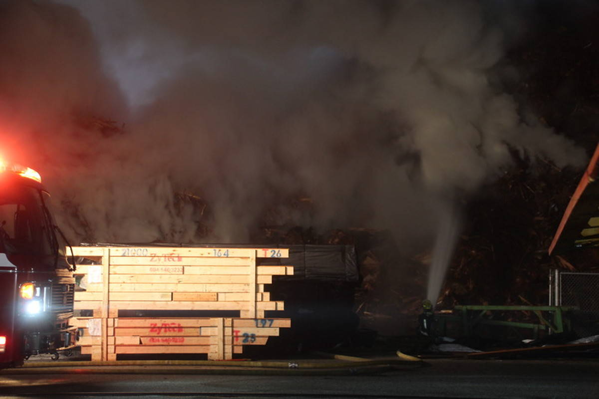 UPDATE: Fire at large woodpile fire at Langley's Cloverdale Fuel still smouldering