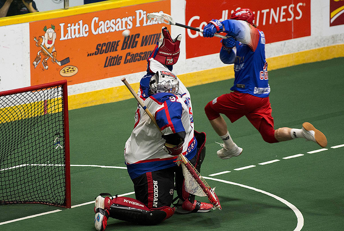 Peterborough Lakers Zach Currier puts one past Maple Ridge Burrards goalie Frank Scigliano during game three of the Mann Cup. (Jessica Nyznik/Examiner)
