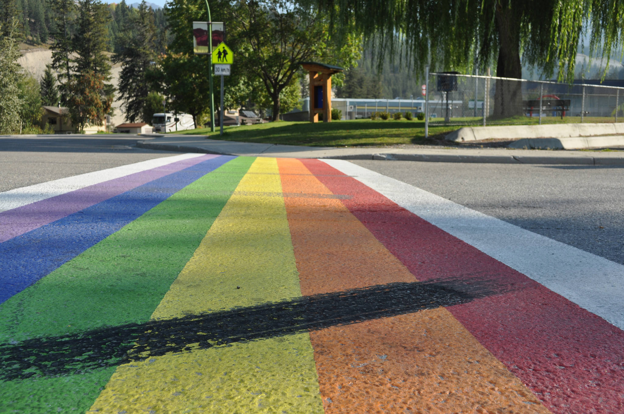 B.C. youth work to clean up burnout left on another rainbow crosswalk