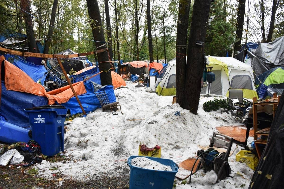The storm waters deposited so much hail in the camp after receding that it looked like a January snowstorm had hit Anita Place. (Neil Corbett/THE NEWS)