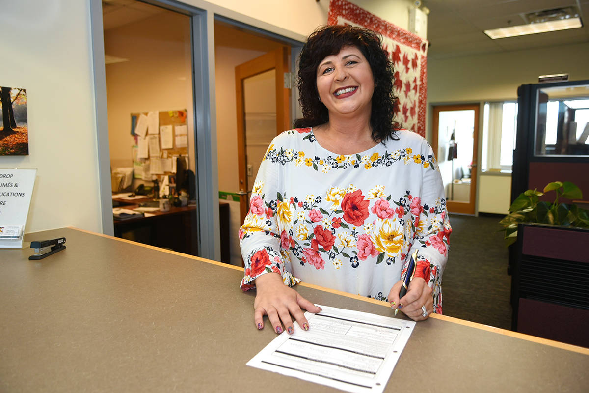 Val van den Broek signs her candidate nomination papers for the 2018 mayors race in Langley City. Miranda Gathercole Langley Times