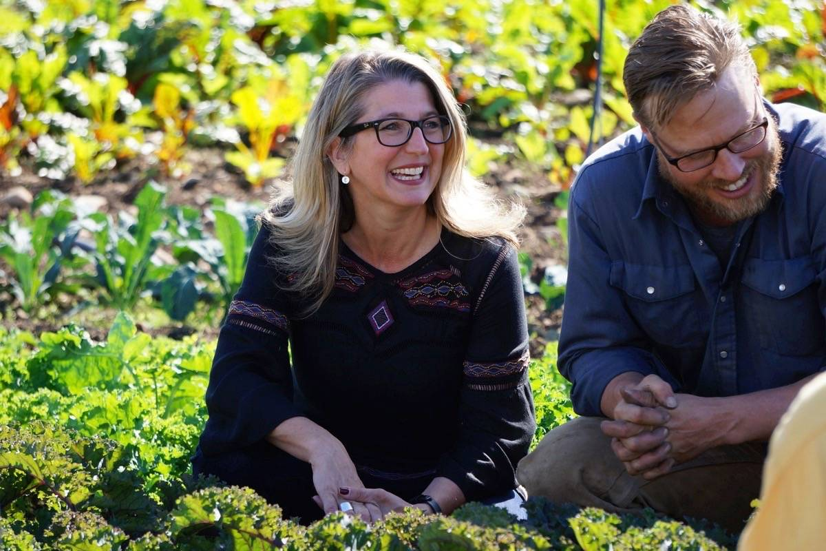 Minister of Agriculture Lana Popham gets a tour of Parksville's Salt & Harrow Farm by owner and operator Seann Dory on Sept. 18 before she announced a $300,000 commitment from the province to help farmers access affordable farm land. — Karly Blats photo