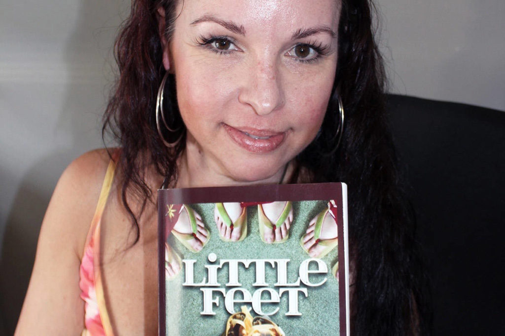 Heather Williams with her autobiography Little Feet about how her life changed in an instant. (Photo by Don Bodger)