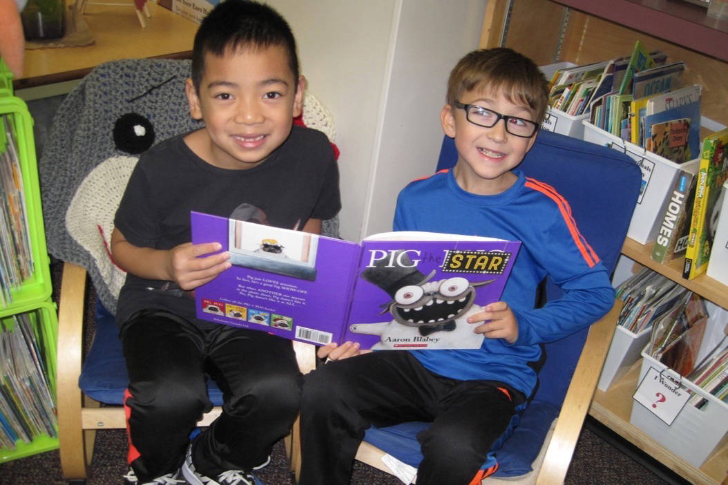 Payton Truc, left, and William Page helped to write the letter to send in the package to the students at Hornby Island Community School. (Contributed)