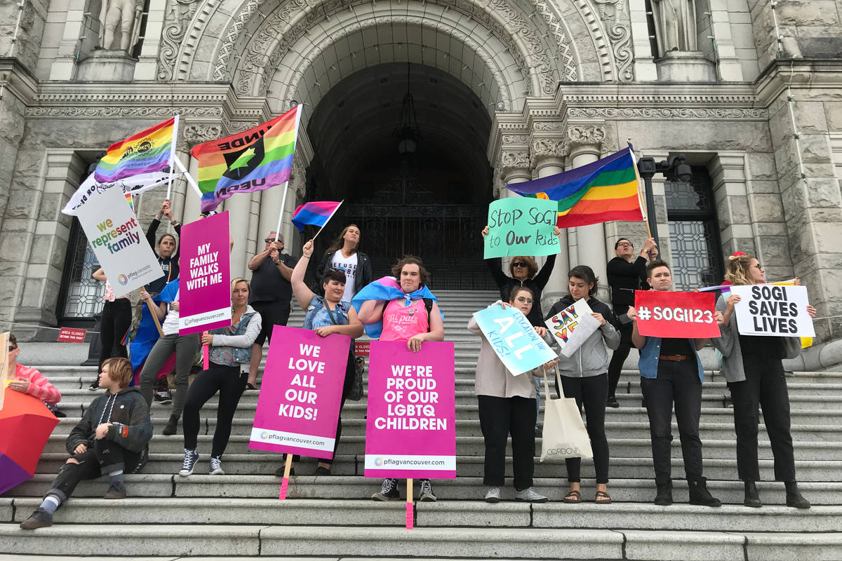 Protesters and counter-protestors share their polarizing views on the contentious SOGI 123 curriculum at the B.C. Legislature Sept.29. (Keri Coles/News Staff)