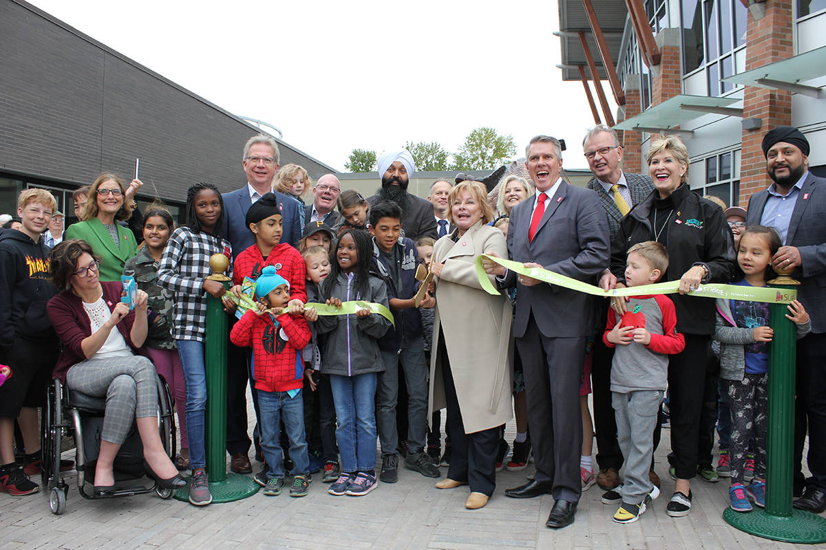 Surrey Mayor Linda Hepner gets a helping hand in the ribbon cutting ceremony for the Museum of Surrey from youth who attended the grand opening on Saturday, September 29. (Samantha Anderson)