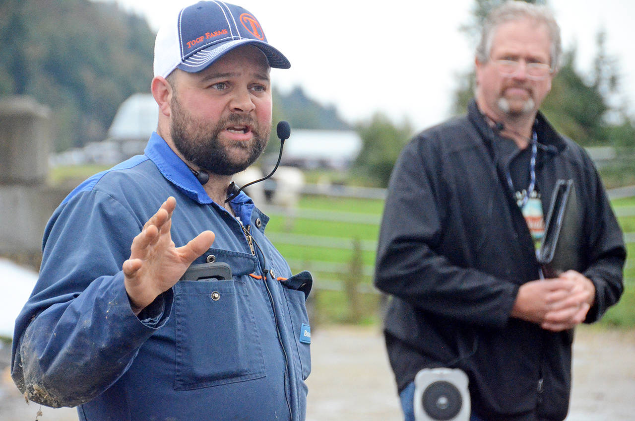 Sixth generation dairy farmer Devan Toop talks to attendees at Toop Farms on Sept. 21 during the 17th annual Chilliwack Agriculture Tour. (Paul Henderson/ The Progress)